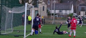 The ball is in the back of the Pupils' net for Saints' third goal, but who scored it – Craig MacEwan or Marc Maccallum? After lengthy deliberation the goal was eventually given to Maccallum.