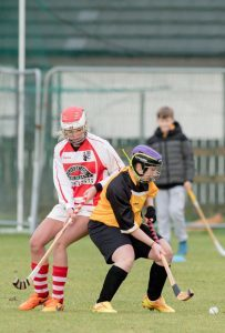 Lochabers Claire Delaney head to head with Forts Elaine Wink. Abrightside Photography. F06 Ladies Shinty 3no JP