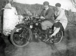 A nurse and friend on her motorcycle.