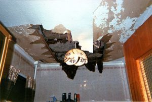 The leak was traced to a loo in the ACHA flat above, but the housing association has not repaired the falling ceiling.