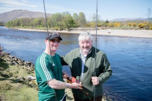 Chris cairns new secretary gives a bottle of whisky to Andy Donaldson former secretary for his service to the club. Abrightside Photography. F19 Inverlochy Fishing 2no JP