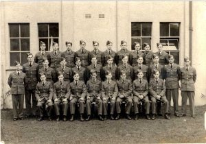 Flt Sgt Robert James, seated front row fourth from right, photographed with his squadron.