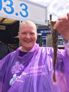 Sue Pagan, dementia adviser with Alzheimer Scotland bravely decided to have her head shaved to raise money for the charity. Photograph: Marian Milarvie/Stripey Straws DV Production.