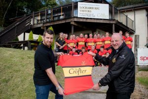 The Crofter Bar owner Dale Monk, left, presents Lochaber RFC president Ali MacKinnon with the first XV's new alternate strip ahead of Saturday's game against Moffat. 2JP F36 Lochaber RFC new away strip