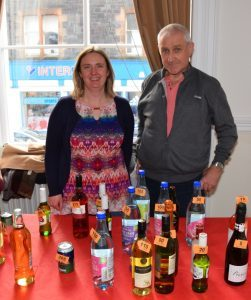 Kitty Millar and Gilbert McKillop man the bottle stall. 50_c48pipebandcoffee02_bottle