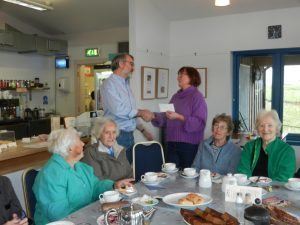 Ian Henry of Glensanda presents the cheque for £1,500 to Gilly Dixon-Spain, with Mairi Smith, Margaret MacDonald, Carol Wormleighton and Barbara MacDougall. NO_T45_lismore01
