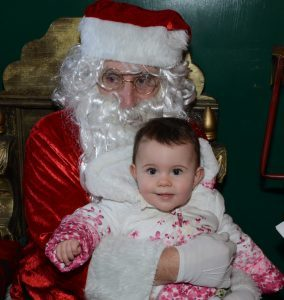 11-month-old Mirren Dickson meets Santa Claus.