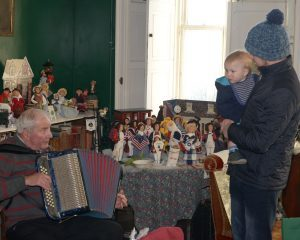 Accordionist Alec MacKinnon plays for Angus Fee, 10 months and his dad Daniel Fee.