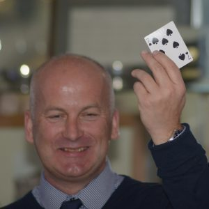 Stan Irwin selects the seven of spades.