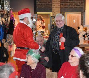 Steve Byrne receives a present from Santa. 50_c50mondaysocial01_steve byrne