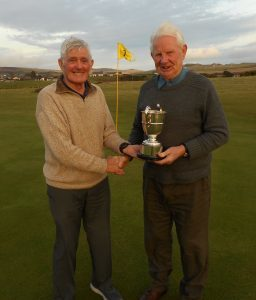 Last year's winner Bill Brannigan, left, presents Sandy Watson with the Heidbangers Cup. NO_c52heidbangers02