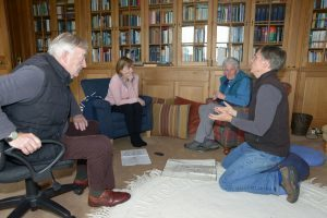 Don Dennis, far right, describes Achamore house to from left: Alasdair McNeill, Helen Haugh and Susan Allan in the library.: