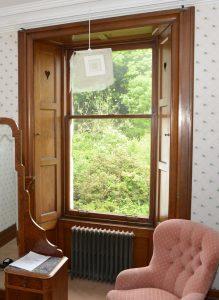 Hearts cut in window shutters.