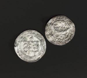 A hoard of silver was buried with Anglo-Saxon and Arabic coins at Storr Rock on Skye around 935 to 940. The nature of the hoard and mixture of coins and bullion from far-flung areas indicate that it belonged to a Viking trader or settler. In the Viking world, silver and, to a lesser extent, gold were used as a medium of exchange, weighed on balances. Any type of silver, complete objects, coins or hacksilver, was valid tender. Much of the silver was nicked and bent to test its purity.