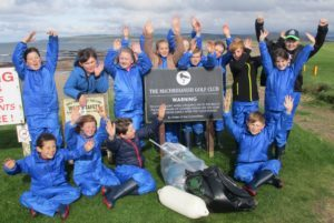 The children help to improve their environment by taking part in beach cleans.