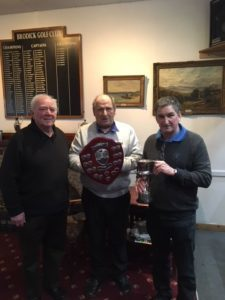 Arran Golf Association chairman Jock Kelso presents the Duncan Trophy to Brodick team captain Brian Smith (right) and runner up shield to Whiting Bay's Wolfi Kroner.
