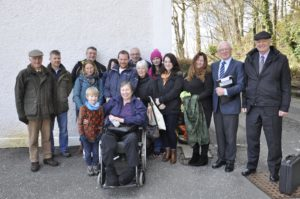 Graham MacQueen, second right, with his wife Morven and son Mark, centre, celebrate outside a local hearing at Oban's Corran Halls, which agreed to save a hut he built without permission for his disabled family.
