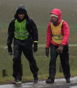 They were still smiling as they approached the end, despite injuries and the weather.