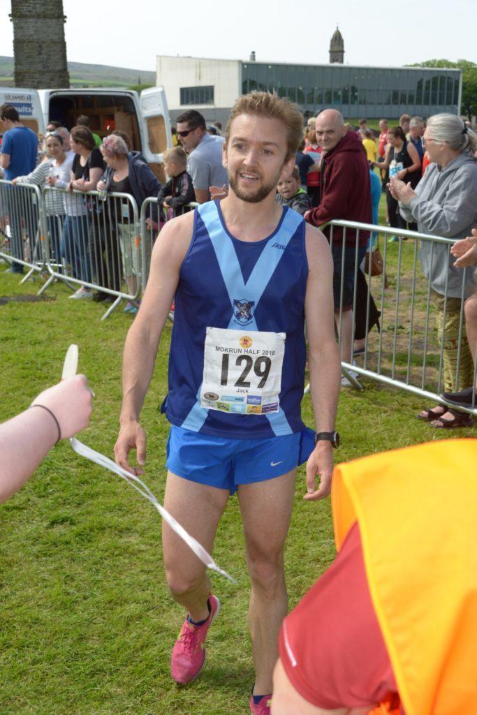 Jack Arnold wins the half marathon