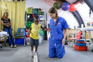 Ortho patient Pierre doing rehab exercises with physical therapist Laura Blundell. Photo: Mercy Ships