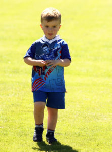 Ollie Maitland's focus was on winning the sweeties at the end of the potato and spoon race. Photo Kevin McGlynn