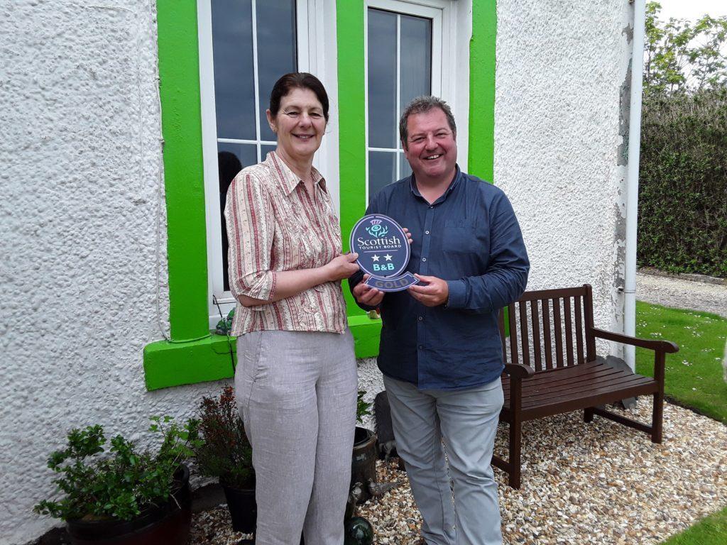 Anne Tait with VisitScotland Regional Director, David Adams McGilp. Credit: Visit Scotland. NO_T24_Anchorage 1