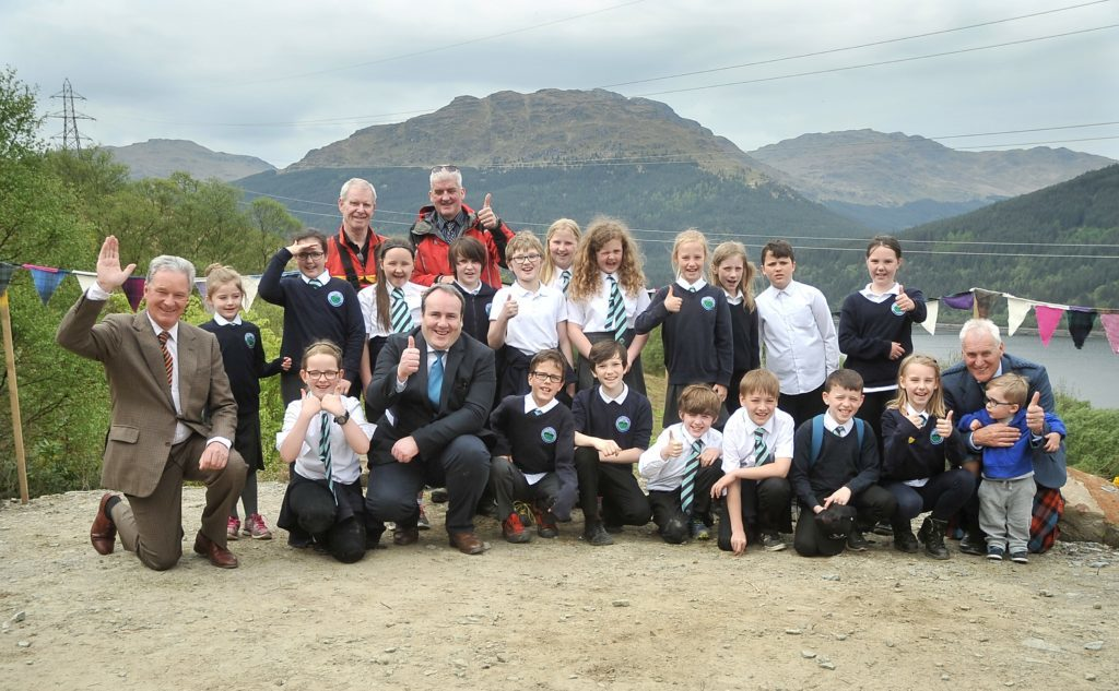 Children from Arrochar Primary School,Sir Malcolm Colquhoun, chairman of Luss Estates Co., Paul Wheehouse MSP, Minister for Business, Innovation and Energy, and Duncan MacLachlan, chairman of Arrochar Community Hydro. NO_T24_Arrochar Community Hydro opens_01