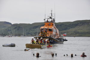 The last Careys raft is pushed home by the helpful lifeboat's waterjet.