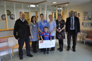 Above, right to left: Callum Semple, treasurer for Campbeltown Loyal Rangers Supporters Club, interim local area manager for the Health and Social Care Partnership Tina Watt, senior staff nurse Catherine Currie, five year-old Billy Gilchrist, son of the club's chairman, health care assistant Leona O'May, Macmillan nurse Maggie Wilkieson, and Dick McFadzean, club committee member.