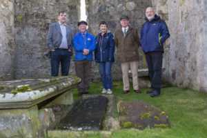 Pictured inside the Ui Church with the Sword Stone, left to right: Alex John Murray, Ui Church Trust committee member; Colin Scott Mackenzie, Ui Church Trust honorary president; Liz Chaplin, secretary of the Ui Church Trust; John Kennedy, a descendant of the Macleods of Lewis; and Donald John MacSween, general manager of Point and Sandwick Trust. Photograph: Sandie Maciver of SandiePhotos.