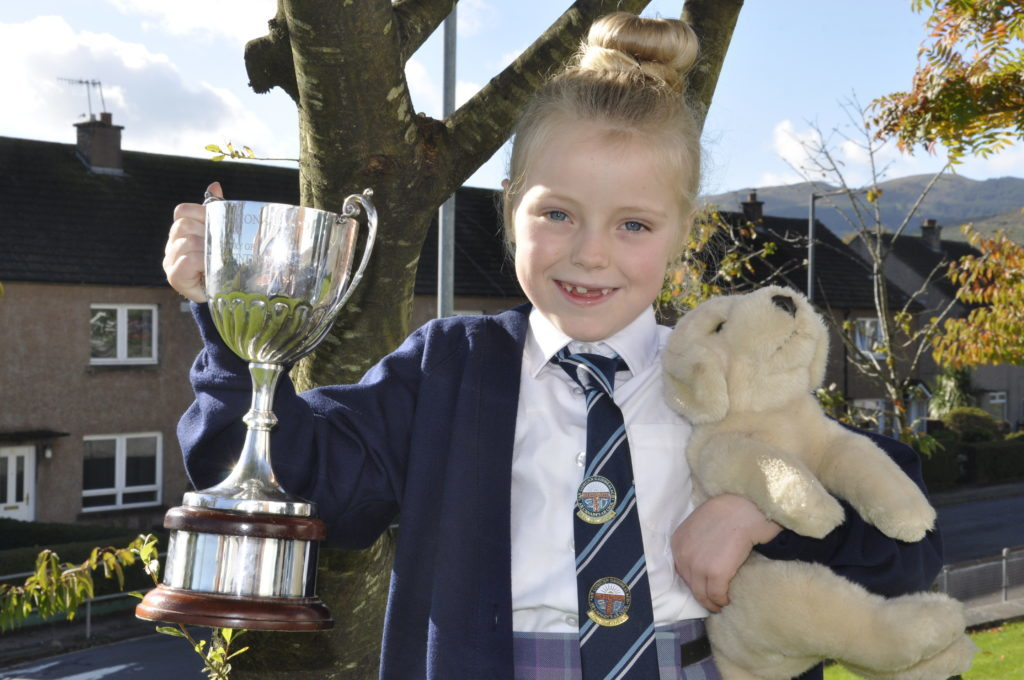 Eva Bisp, 7, from Rockfield, won the 7-8 learners singing competition, with help from 'Oscar the Mod dog'. 15_MOD42DM7_poetry