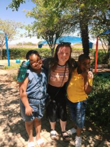 Megan Evans with pupils from the enrichment centre in Limpopo where she is spending one year as part of Project Trust. NO_T48_MeganEvans