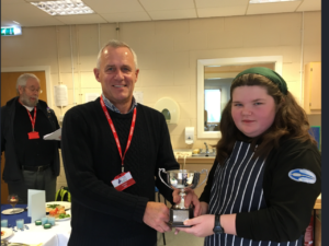 Runner-up Katie MacGillivray, from Acharacle, receives her prize from Rotary Club president Iain Johnston. NO F50 young chef Katie