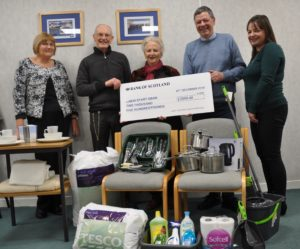 New Start Oban's chairperson Antoinette Mitchel with treasurer David James and Douglas Mackie who is Chairman of West Highland Housing presenting the cheque, along with Diane MacDonald and Iona Smith who are also part of New Start Oban. NO_T01_newstartoban