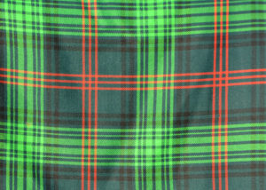 Samples of tartan showing the difference between muted vegetable (red) and the harshersynthetic (black and green) dyes. Photograph: Iain Thornber