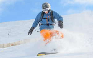 Snowboarder Chris Hawkes from Inverness, hunting for fresh snow beside the Alpha poma at Nevis Range, Fort William. Photograph: Steve McKenna. NO F06 Nevis Range Feb 19 02