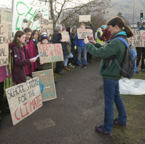Leading Friday's school climate strike outside Lochaber High School, Holly Gillibrand is filmed for social media by her mum, Kate Willis. PICTURE IAIN FERGUSON, THE WRITE IMAGE NO F08 SCHOOL STRIKE HOLLY GILLIBRAND 02