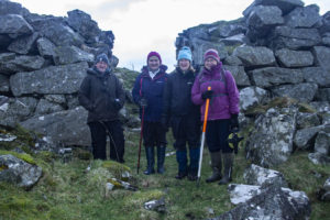 History group members Ian Marshall, Christine McDiarmid, Margaret Gardiner and Mary Braithwaite at Leccamore iron age fort on Luing. NO_T11_Luinghistorygroup03-LeccamoreFort