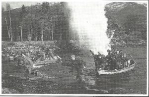 The loch was also used for live fire training, as seen from the explosion behind this group of commandos. NO F16 fire lichen commandoes in boat
