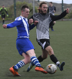 Mallaig's David Currie is tackled by Kyle's  Callum Flanagan . Picture Iain Ferguson, alba.photos  NO F19 Mallaig FC v Kyle 02