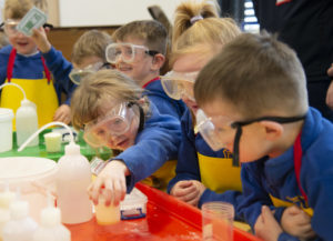 Budding young chemist Zara Findlay reaches for her experiment. Picture Iain Ferguson, alba.photos NO F22 Generation Science 02