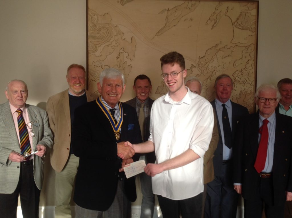 Adam Hill from North Connel accepting a cheque for £150 from Oban Rotary President, Iain MacIntyre. NO_T19_ObanRotary