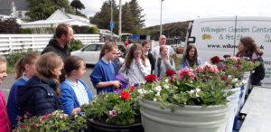 Richard Robertson gives the Guides tips on looking after the displays of flowers. NO F24 HARRIS Guides 02