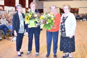 Ann May and Mary Black presented Margaret MacLean and Catherine Carswell with flowers in recognition of their years of dedication to Friends of Oban Hospice.