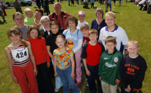 Jenya Navumenka (right, in green) at the 2004 Fort William Highland Games with the children from Belarus. NO F28 CHERNOBYL CHILD RETURNS 05