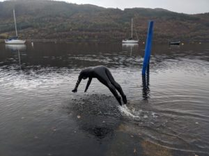 Laura McConnachie dives into the loch for another open water swimming session. Picture: Nic Goddard. NO F31 open water swimmer 04