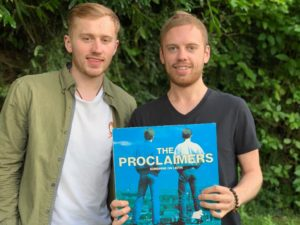 Louise Bell and his brother, Oscar, with their late dad Ian's own original vinyl copy of the Proclaimers' album, 'Sunshine on Leith'. NO F34 Louie and Oscar Bell proclaimers