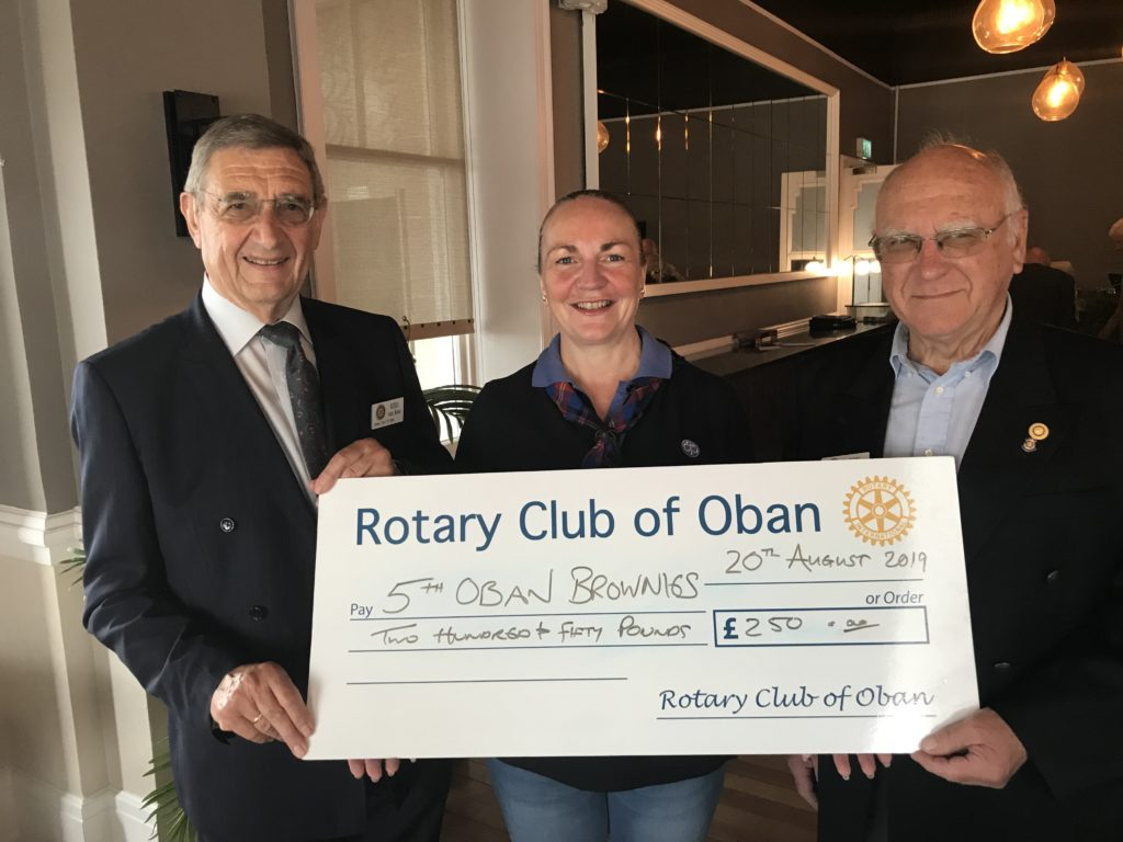 Pictured accepting a cheque is Oban Brownies' new Brown Owl Ciorsti Baxter with Rotary senior vice president Kees van Rein and former president Ken Oxland. NO_T26_Rotary01