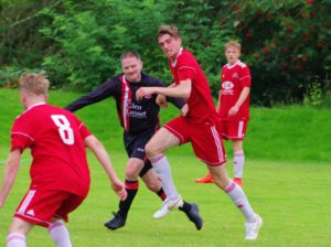 Saints two-goal striker Cammy Hill takes on Clydebank defender Kevin Stanley.