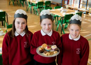 Some of the primary seven pupils who helped at the coffee morning.Photograph: Abrightside Photography. NO F41 MacMillan coffee morning at Banavie primary-2
